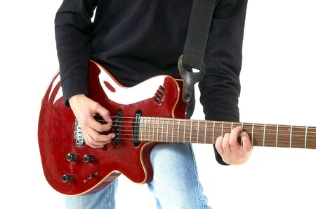 a guitarist boy playing guitar: guy playing guitar on white background