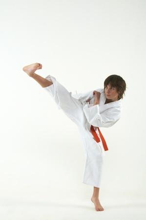 karate boy: boy practicing karate on white background