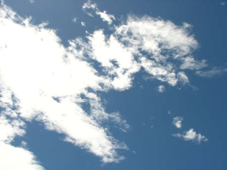troposphere: White fluffy clouds in the blue sky