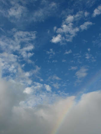 appeared: Sunny rainbow appeared in the sky Stock Photo