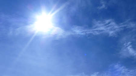 The sun shines in the blue sky