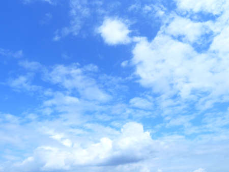 evaporacion: White fluffy clouds in the blue sky