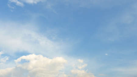 buoyancy: White fluffy clouds in the blue sky