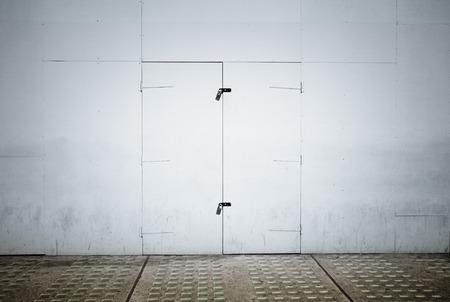locked door: Locked door in a wall and sidewalk Stock Photo