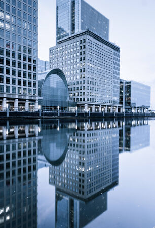 Reflections of buildings in water, Canary Wharf, London photo