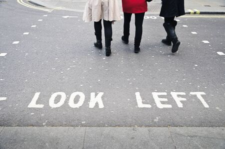 look at right: Typical crosswalk in London with look left and look right sign painted on asphalt Stock Photo