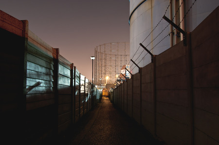 Dark alley in a bulding site at night