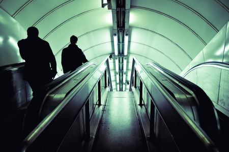Woman travelling in the London underground.