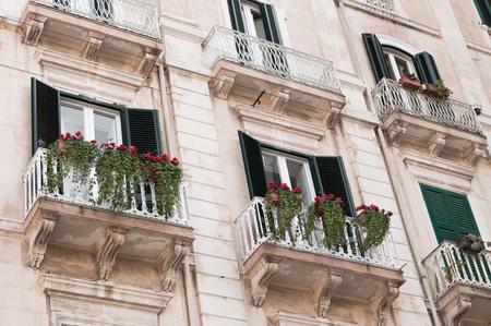 Italian balconies with flowers Фото со стока