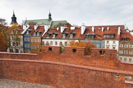 Typical houses in old town of Warsaw and medieval wall