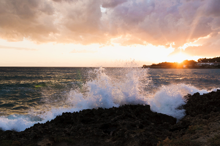 Waves crushing agains the rocky coast in Apulia, Mediterranean sea, Italy