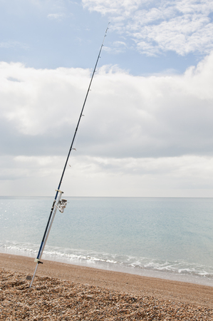Camping and fishing on the beach Фото со стока