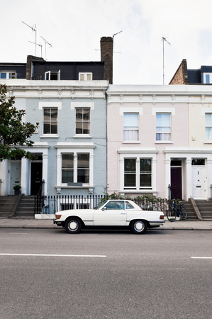 Street in West London with typical Victorian houses and vintage car