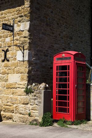 Telephone boot in a countryside village, UK 免版税图像