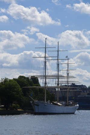 chapman: View of historical sailing vessel  Af Chapman  moored at the dock of Skeppsholmen island in Stockholm, Sweden