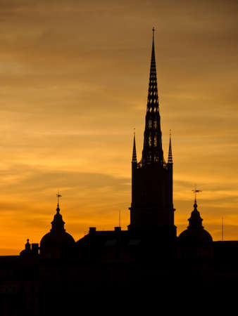 View of Stockholm old town and Riddarholmen church tower at sunset Stock Photo