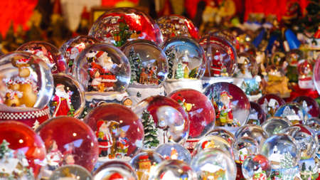 Many snow domes with various Christmas scene at a Christmas market