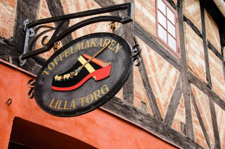 lilla: Malmo, Sweden - August 2010: Wooden shop sign on an historic building in Lilla Torget in Malmo, Sweden