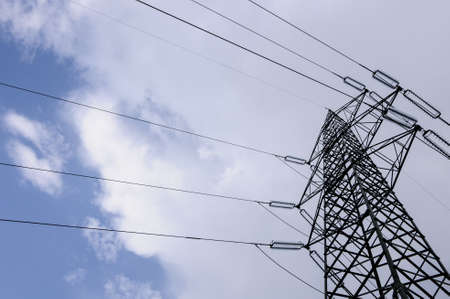 distributing: High voltage power tower and cables used for distributing electricity