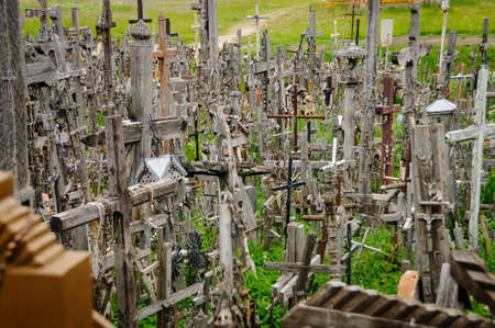 oppression: The hill of the Crosses in Lithuania, one of the most important pilgrimage sights of the region and a national monument commemorating Soviet oppression.