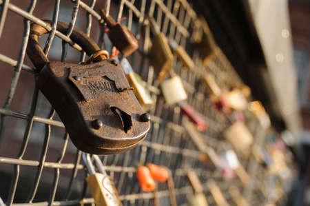Love locks on a bridge railing in Tampere, Finland, Europe
