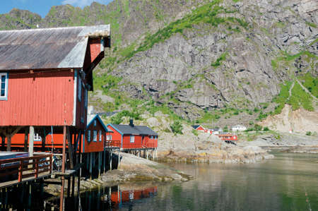 Red rorbu, traditional fishing huts, in the small fishing village of A, Moskenes, Lofoten Islands, Norway, Europe
