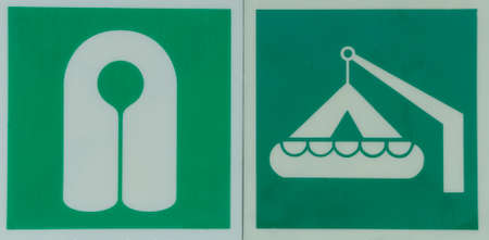 White life vest and lifeboat symbols on a green background Stock Photo