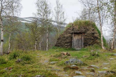Sami culture: a a turf hut (darfegoahti) in a Sami Camp in Abisko National Park Stock Photo