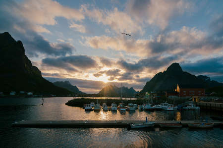 Evening sunset on the harbor of the fishing village of Reine, Moskenes, Lofoten Islands, Norway, Europe Stock Photo