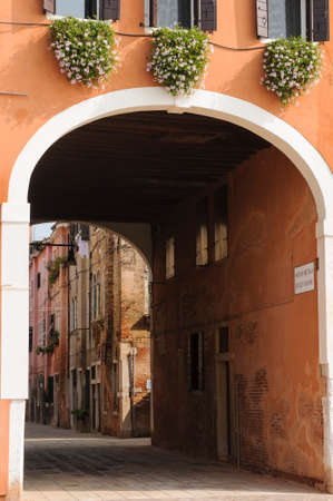 Narrow cobblestone alley in the historical center of Venice, Veneto, Italy, Europe