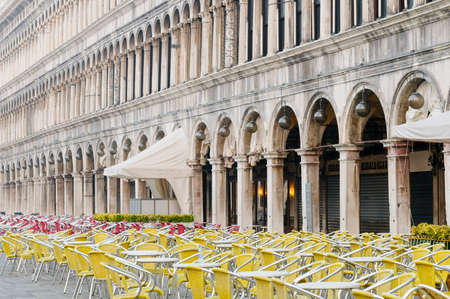 Early morning in Venice. Empty cafe tables and chairs in San Marco Square, Venice, Veneto, Italy, Europe