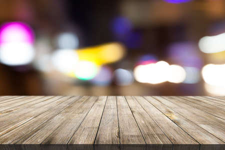 Wooden desk on blur or abstract natural background