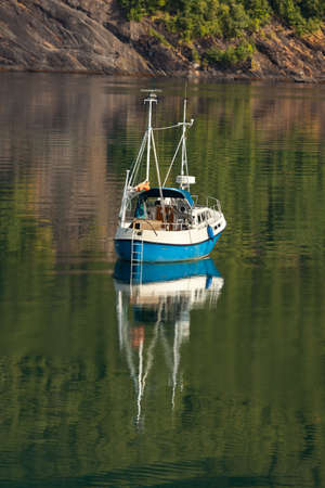 Small beautiful boat in a lake or in a large river natural background 版權商用圖片