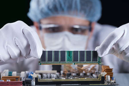 Scientist working with a computer motherboard, technology concept Reklamní fotografie
