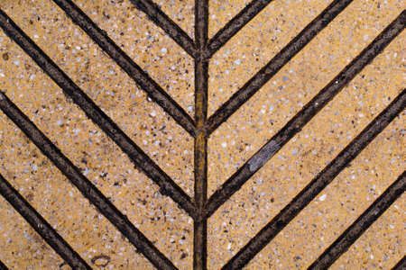 blotches: Brown tile with dark blotches forming arrows