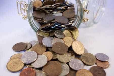 kopek: Coins spill out of the jar Stock Photo