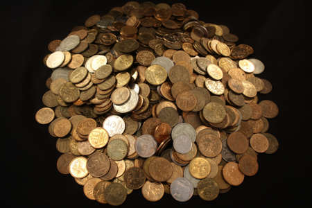 placer: Placer coins on a black background