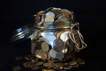 kopek: Coins in a glass jar on a black background Stock Photo
