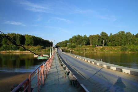 pontoon: Pontoon bridge on the river Sura. Russia Stock Photo