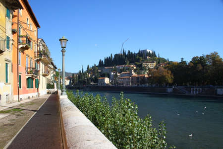 Embankment of the river Adige and the hill of San Pietro. Verona, Italy Stock Photo