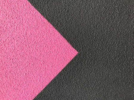 texture of red granular wall. grainy surface texture. the grainy texture of the red wall. the grainy texture of the wall surface, painted in pink lines and sharp corners, black and pink complement each Banque d'images