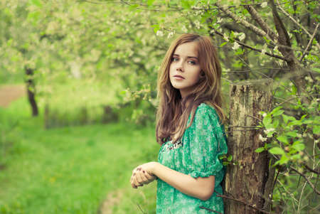 beautiful girl in the spring garden Stock Photo - 15717277
