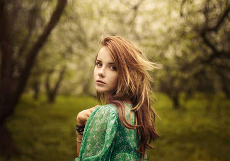 beautiful sad: beautiful girl looks in the garden