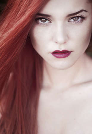 fashion portrait of redhead girl closeup photo