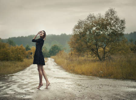 spring fashion: beautiful girl in the rain