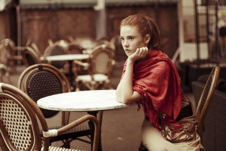 beautiful girl relaxing in the outdoor cafe Stock Photo