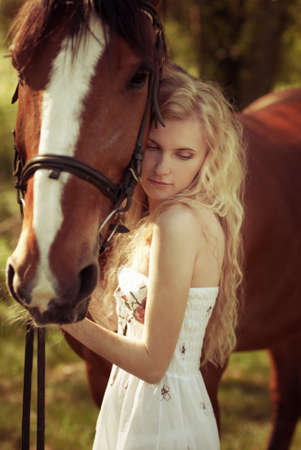 portrait of a beautiful girl with horse photo
