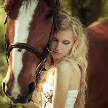 horse blonde: portrait of a beautiful girl with horse