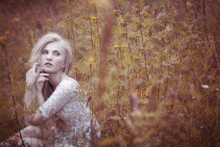 wise woman: beautiful blonde in the field Stock Photo