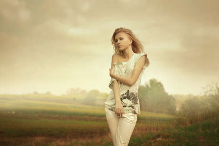 Beautiful girl posing in a field Stock Photo